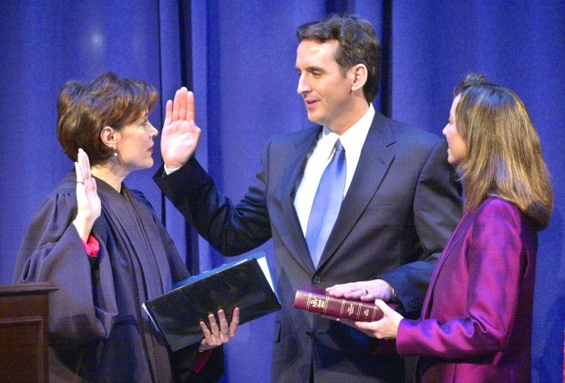 With his wife Mary holding the Bible, Tim Pawlenty is sworn-in as Minnesota governor by Chief Justice Kathleen Anne Blatz during an inauguration ceremony at Landmark Center in St. Paul on Monday, Jan 6, 2003. (Joe Rossi / Pioneer Press)