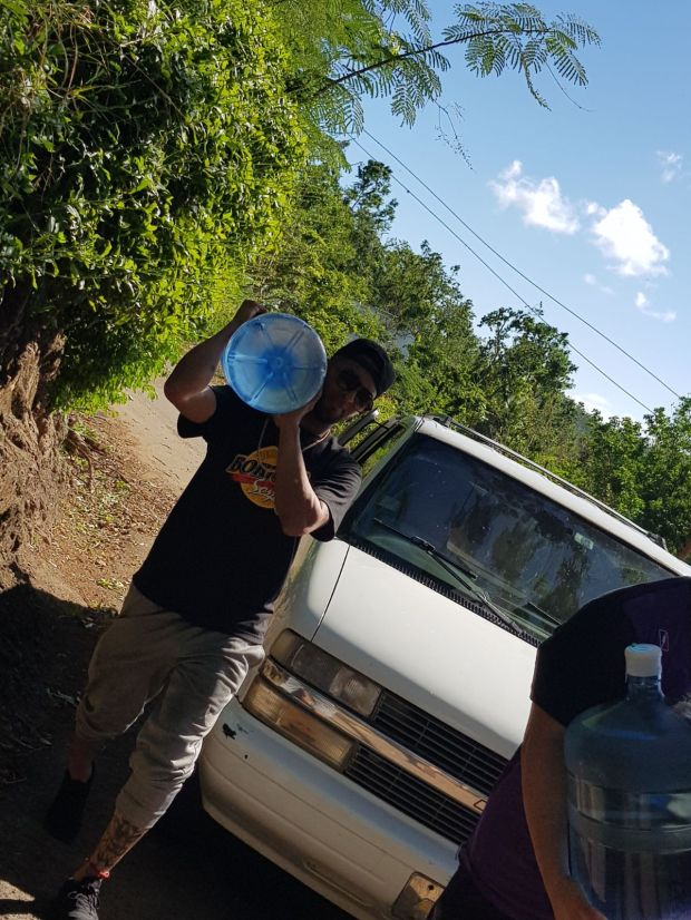 Twins left fielder Eddie Rosario delivers water to residents of Puerto Rico in December as part of hurricane relief efforts.