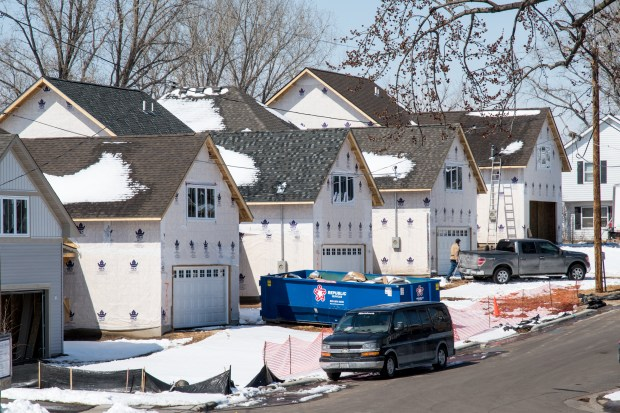 Houses under construction as part of the Rivoli Bluff housing project, on an East Side bluff overlooking downtown St. Paul, are seen Thursday, April 5, 2018. (Andy Rathbun / Pioneer Press)