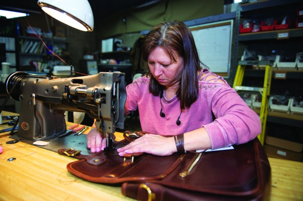 Luba Evarts who has worked at J.W. Hulme for 11 years, finishes her latest piece in their onsite manufacturing site which has been handcrafting quality leather goods sourced small craft tanneries for more than a century. Leather goods come in the form of wallets, handbags, luggage and more Thursday, February 22, 2018. (Special to the Pioneer Press: Craig Lassig)