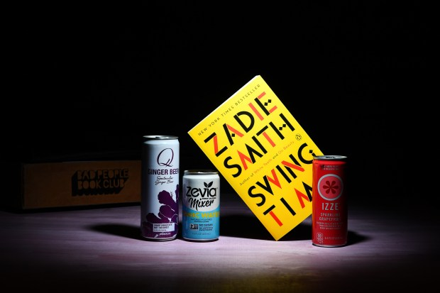 """Inside a sample of the Bad People Book Club box are """"Swing Time,"""" by Zadie Smith and cocktail fixings. Katherine Frey / Washington Post)"""