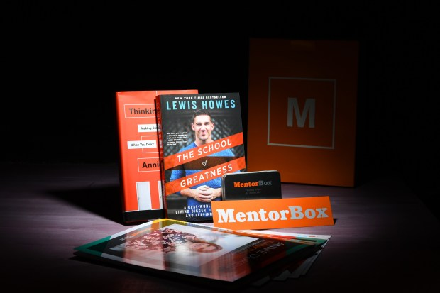 """The Mentor Box is aimed at business-book readers. A sample box features """"The School of Greatness,"""" by Lewis Howes, along with Annie Duke's """"Thinking in Bets."""" Katherine Frey / Washington Post)"""