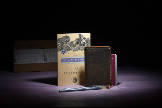 """A sample of the Culture Carton book box subscription includes John Steinbeck's """"Of Mice and Men"""" as well as pencils and a leather bound notepad. Katherine Frey / Washington Post)"""