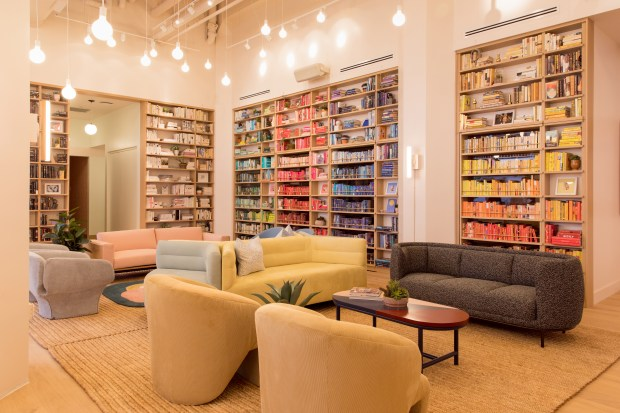 The Wing, a chain of women-only co-working spaces and social clubs, organizes books by spine color, a very Instagram-friendly design. (The Wing; photographer Tory Williams)