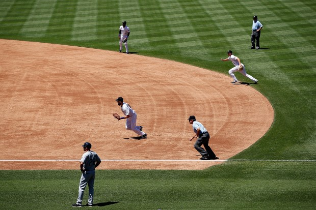 DENVER, CO - AUGUST 05: The Colorado Rockies infield employ the infield shift as they defend against the Seattle Mariners during interleague play at Coors Field on August 5, 2015 in Denver, Colorado. The Rockies defeated the Mariners 7-5 in 11 innings. (Photo by Doug Pensinger/Getty Images)