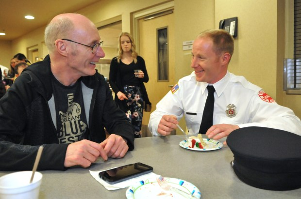 "Derek Baker, right, chats with his father, David, at a reception after 19 new St. Paul firefighters who graduated from the city's Firefighter Academy during a ceremony at the Paul and Sheila Wellstone Center in St. Paul on Friday, May 11, 2018. Baker waited a long time to become a St. Paul firefigher but late last year, he said he ""finally got the dream call,"" notifying him he'd been selected to become a St. Paul firefighter. (Ginger Pinson / Pioneer Press)"