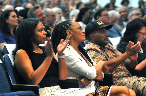 Dr. Sakeena Futrell-Carter, wife of St. Paul Mayor Melvin Carter, left, sits with Carter's mother, Toni Carter, center, Ramsey County Commissioner and his father Melvin Carter, Jr., retired St. Paul Police Sergeant, as Carter delivers his State of our City Address at Johnson Senior High School in St. Paul on Saturday, May 19, 2018. Afterwards attendees had the opportunity to engage in small group discussions to provide feedback about their vision for Saint Paul. (Ginger Pinson / Pioneer Press)
