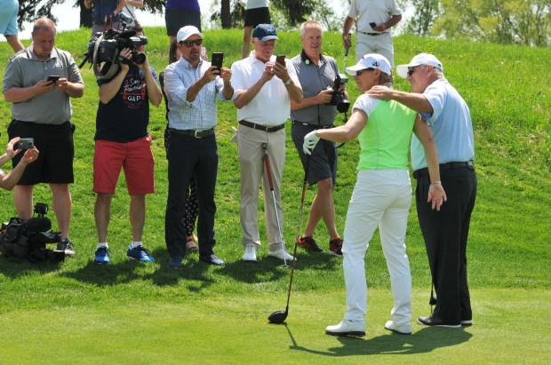 Hollis Caver, right, poses for photos with legendary golfer Annika Sorenstam after the two teed off on the first hole during the celebration of the opening of Royal Golf Club in Lake Elmo Friday, May 18, 2018. Cavner is the developer behind the project, an 18-hole, $20 million, 292-house, 428-acre mega-development at what was once 3M's Tartan Park. The course was designed Sorenstam and Arnold Palmer. (Ginger Pinson / Pioneer Press)