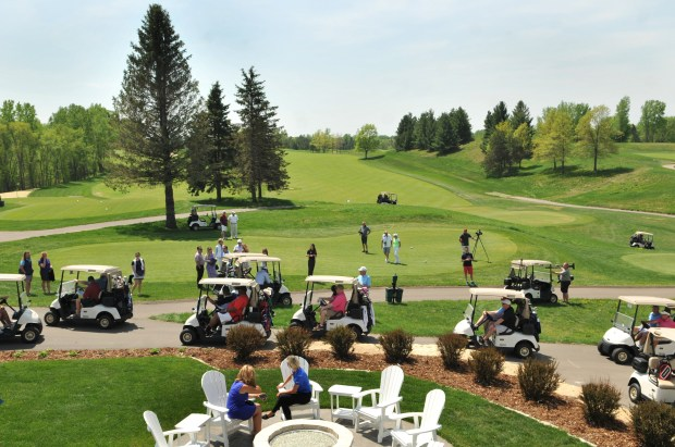 Golfers fill the limited edition Arnold Palmer golf carts as people head out to golf after the grand opening celebration of the Royal Golf Club Golf Course in Lake Elmo at the new club house and golf course on Friday, May 18, 2018. The course founded by Hollis Cavner and designed by Arnold Palmer and Annika Sorenstam is located on rolling hills, mature trees where the 27-hole complex formerly known as Tartan Park in Lake Elmo, Minn once stood and offers a golf club and Arnie's restaurant along with spaces available for meetings and events. (Ginger Pinson / Pioneer Press)