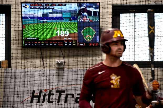 Minnesota Gopher baseball players take batting practice with the new Hit Trax computer technology, which measures how hard the ball is hit and where it will fly, Wednesday May 2, 2018, at Siebert Field, Minneapolis. Former Gophers and Minnesota Twins pitcher Glen Perkins donated $500,000 toward the University of Minnesota's new batting cage, which is complete with high-tech gadgets to gauge quality swings. It will be unveiled at Friday's game at Siebert Field. (Jean Pieri / Pioneer Press)