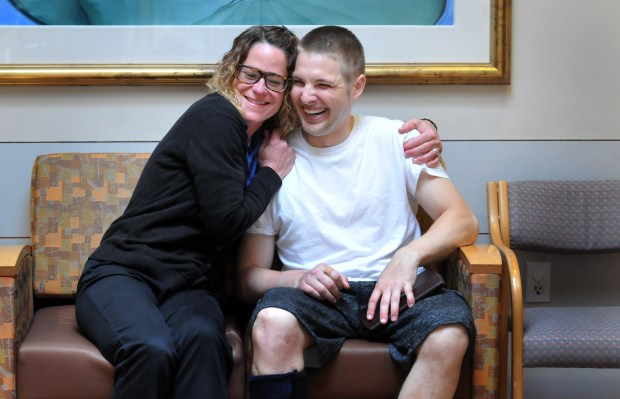 "Mitchell Radziej gets a hug from Lisa Rae Caturia, an occupational therapy assistant he formerly worked with, at Courage Kenny Rehabilitation Institute-St. Croix in Stillwater on Wednesday, May 9, 2018. He said he has started talking to school groups about his accident and meth use. His goal is to become a motivational speaker, he said. ""I'm very lucky,"" he said. ""I know that. There's a reason I'm here."" (Ginger Pinson / Pioneer Press)"
