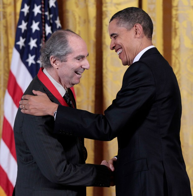 In this March 2, 2011, photo, President Barack Obama, right, presents a National Humanities Medal to novelist Philip Roth during a ceremony in the East Room of the White House in Washington. (AP Photo/Pablo Martinez Monsivais, file)