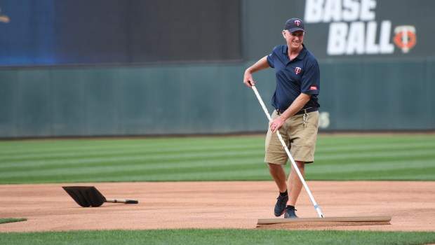 Target Field heads grounds keeper Larry DiVito grooms the first base area of the infield before the start of the Minnesota vs Milwaukee MLB baseball game at Target Field on Friday May 18, 2018. (John Autey / Pioneer Press)