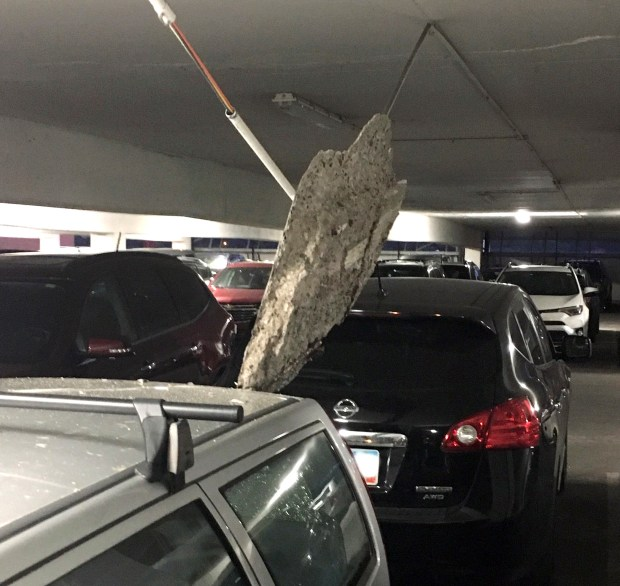 At the RiverCentre Ramp, a piece of ceiling concrete measuring 3 feet by 2 feet fell and damaged a parked vehicle on May 16. No one was injured. (Courtesy of St. Paul Department of Safety and Inspections)