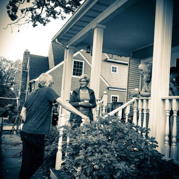 """Cinematographer Greg Winter, director Cynthia Uhrich and LornaLandvik take a break to discuss the porch set-up scene. This is the same porch where Landvik came up with her novel """"Oh My Stars."""" (Photo by Alyssha Rose Jordan)"""