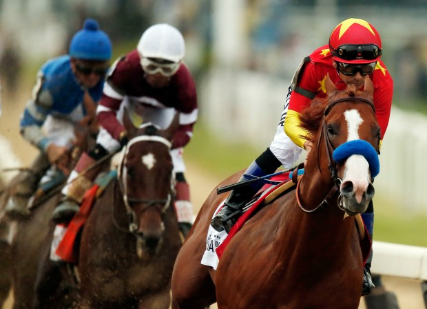Justify (1), with jockey Mike Smith up, leads the pack as it approaches the first turn during the 150th running of the Belmont Stakes horse race, Saturday, June 9, 2018, in Elmont, N.Y. (AP Photo/Andres Kudacki)