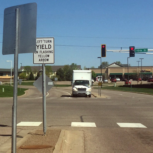The median sign at 10th Street North and Helmo Avenue North in Oakdale. (Mary Divine / Pioneer Press)