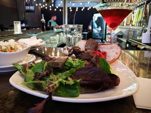 A meatball hoagie and Brooklyn cocktail photographed in June 2018 atthe outdoor bar on Dark Horse Bar and Eatery's patio. (Jess Fleming / Pioneer Press)