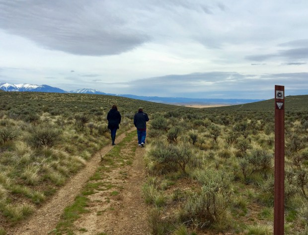Visitors to the National Historic Oregon Trail Interpretive Center outside Baker City, Ore., walk in the ruts formed when hundreds of thousands of pioneers crossed this route headed to the towering Blue Mountains. (Terri Colby/Chicago Tribune/TNS)