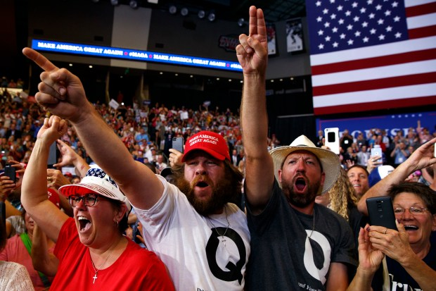 Supporters of President Donald Trump cheer as he arrives for a campaign rally, Wednesday, June 27, 2018, in Fargo, N.D. (AP Photo/Evan Vucci)