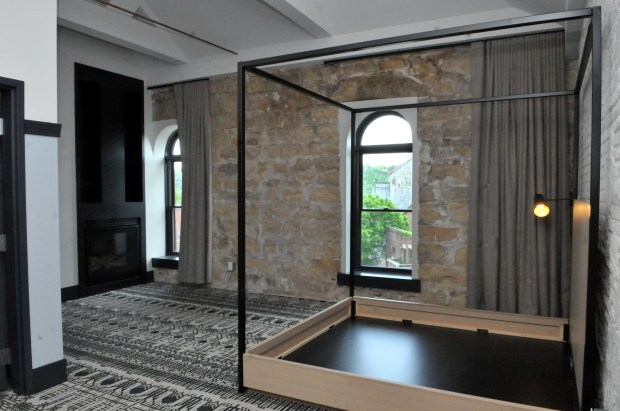 A bedroom with a fireplace and views of downtown Stillwater is seen on the fourth floor of the new Lora Hotel in Stillwater on Thursday, May 24, 2018. The boutique hotel which is tucked into the bluffs on the south end of the of Main Street will be getting more furniture, including armoires and mattresses before the opening date of May 18, 2018. (Pioneer Press / Ginger Pinson)
