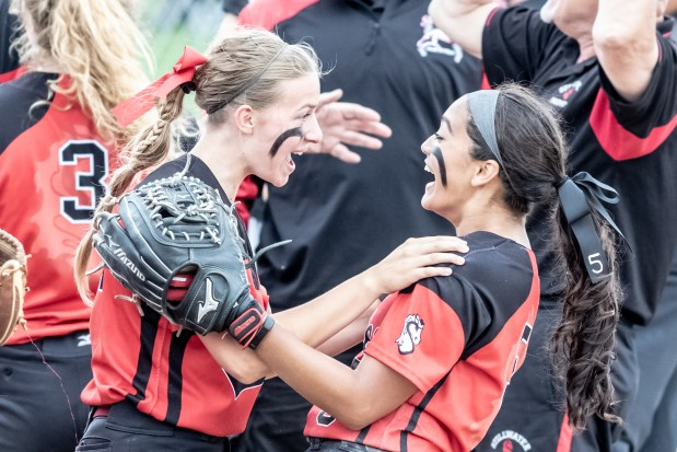 Stillwater sophomore second baseman Haley Eder-Zdechlik and senior shortstop Tatiana Tabucol embrace after the Ponies defeated Park 5-1 in the Class 4A Minnesota high school state softball championship game on Friday, June 8 at Caswell Park in North Mankato. (Photo courtesy of Steve Rooker)