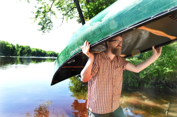 Greg Seitz brings his canoe up to his car after paddling the backwaters of the St. Croix River near Scandia and Marine on St. Croix on Friday, June 1, 2018. Seitz has paddled nearly every inch of the St. Croix National Scenic Riverway and plans to check his last 20 miles off this summer to mark the 50th anniversary of the riverway. (Jean Pieri / Pioneer Press)