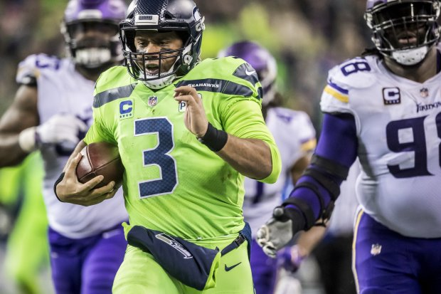 656386559 Seahawks quarterback Russell Wilson takes off on a 40-yard scramble against  Vikings defensive tackle Linval Joseph, right, and defensive tackle Sheldon  ...