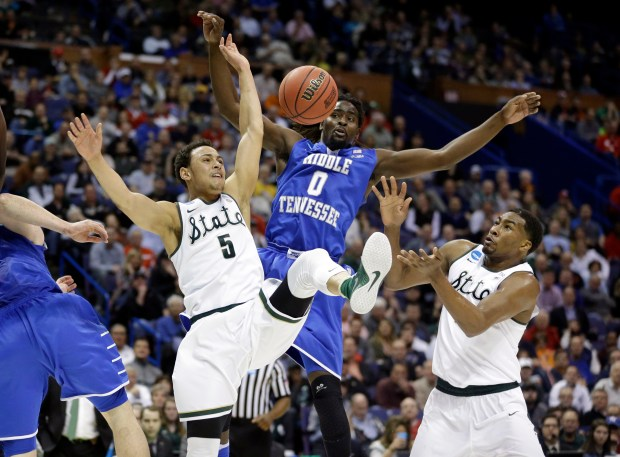 53646986903 Michigan State's Bryn Forbes (5) looses control of the ball on his way to  the basket as teammate Javon Bess, right, watches and Middle Tennessee's  Darnell ...