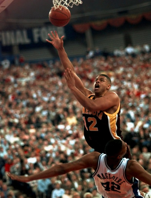 b700275f2ba Minnesota's John Thomas flies to the hoop over Kentucky's Jamaal Magloire  during the first half of their semifinal Saturday, March 29, 1997, ...