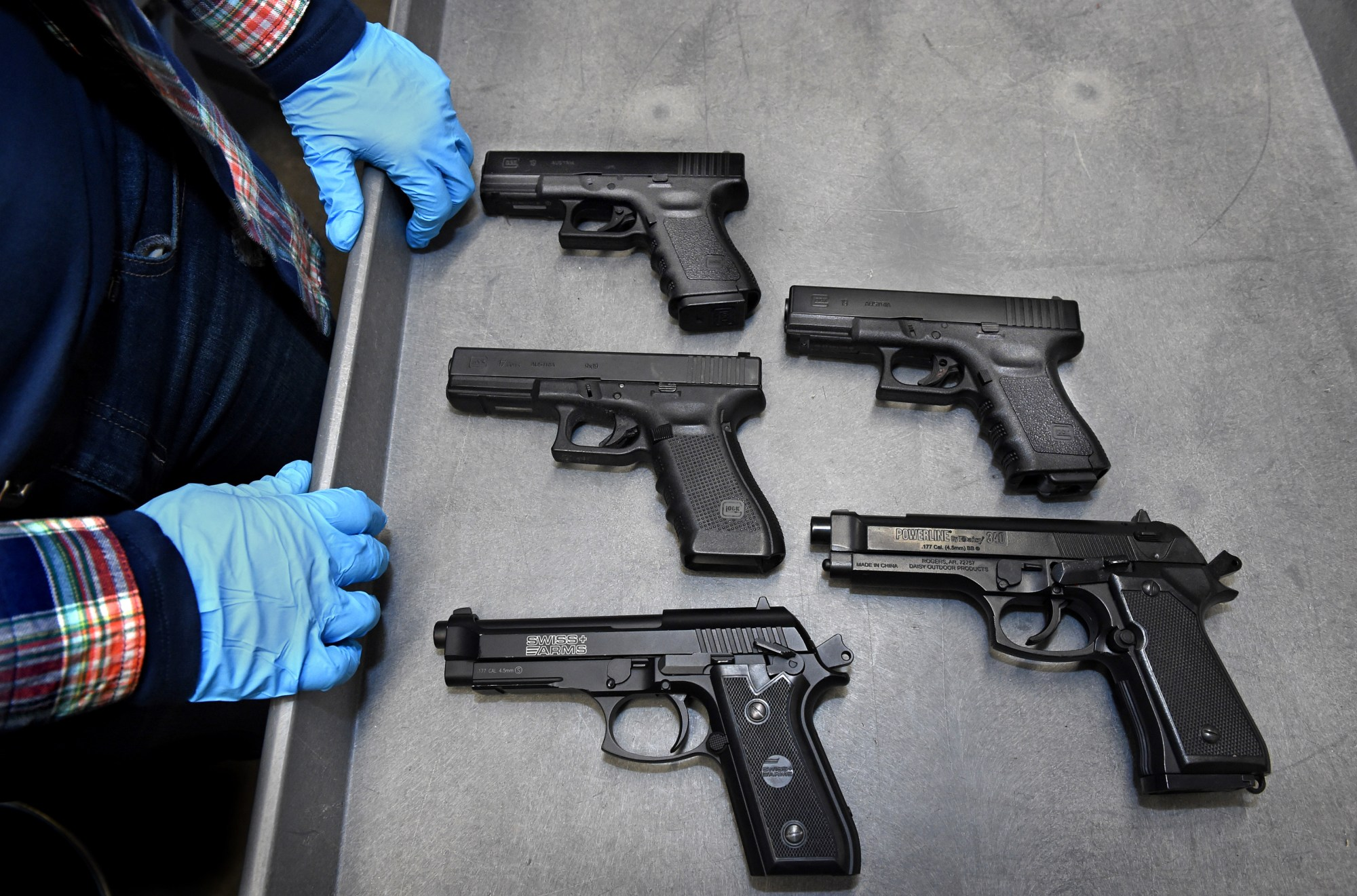 hight resolution of  where is the real gun asks st paul police sgt tina kill as she shows her service duty weapon along with four real looking bb guns that were collected