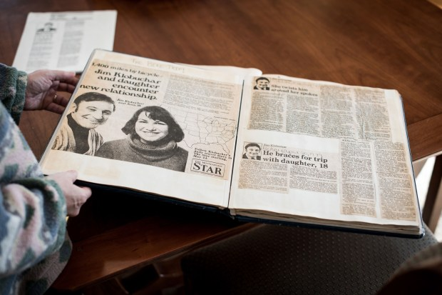 Amy Klobuchar shows a 1981 news clipping from the bike trip she took with her journalist father at 18 from the Twin Cities to the Grand Tetons in Wyoming. (Photo for The Washington Post by Caroline Yang)