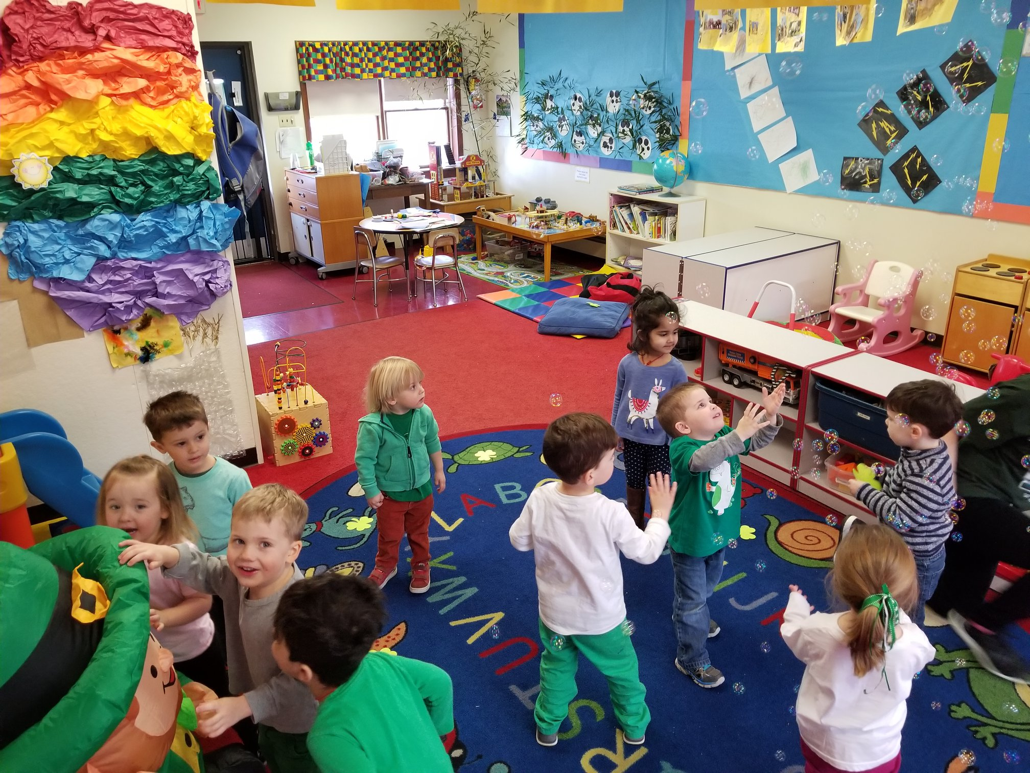 Kids playing in a classroom.