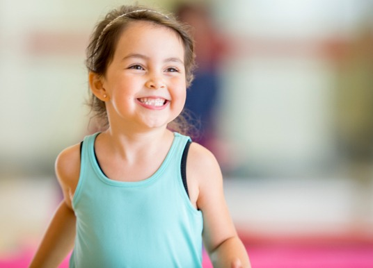 Girl toddler playing in a gym.