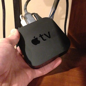 Apple TV in my hand.