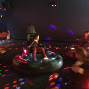 Lily driving the bumper cars.