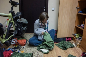 Susanne fitting the inside to the outside fabric of the pogie