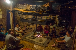 Talking with family around fire place