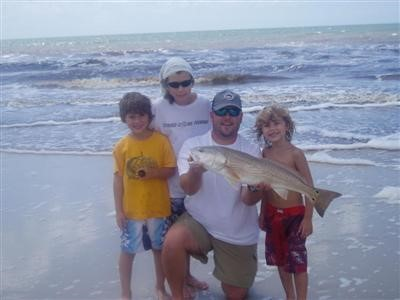 A gorgeous and huge RED caught with a shrimp, from the shore in front of Two Palms just after a Tropical Storm August, 2009. Brian, his wife, and 5 boys from Jacksonville were superstars in preventing water from destroying the home.
