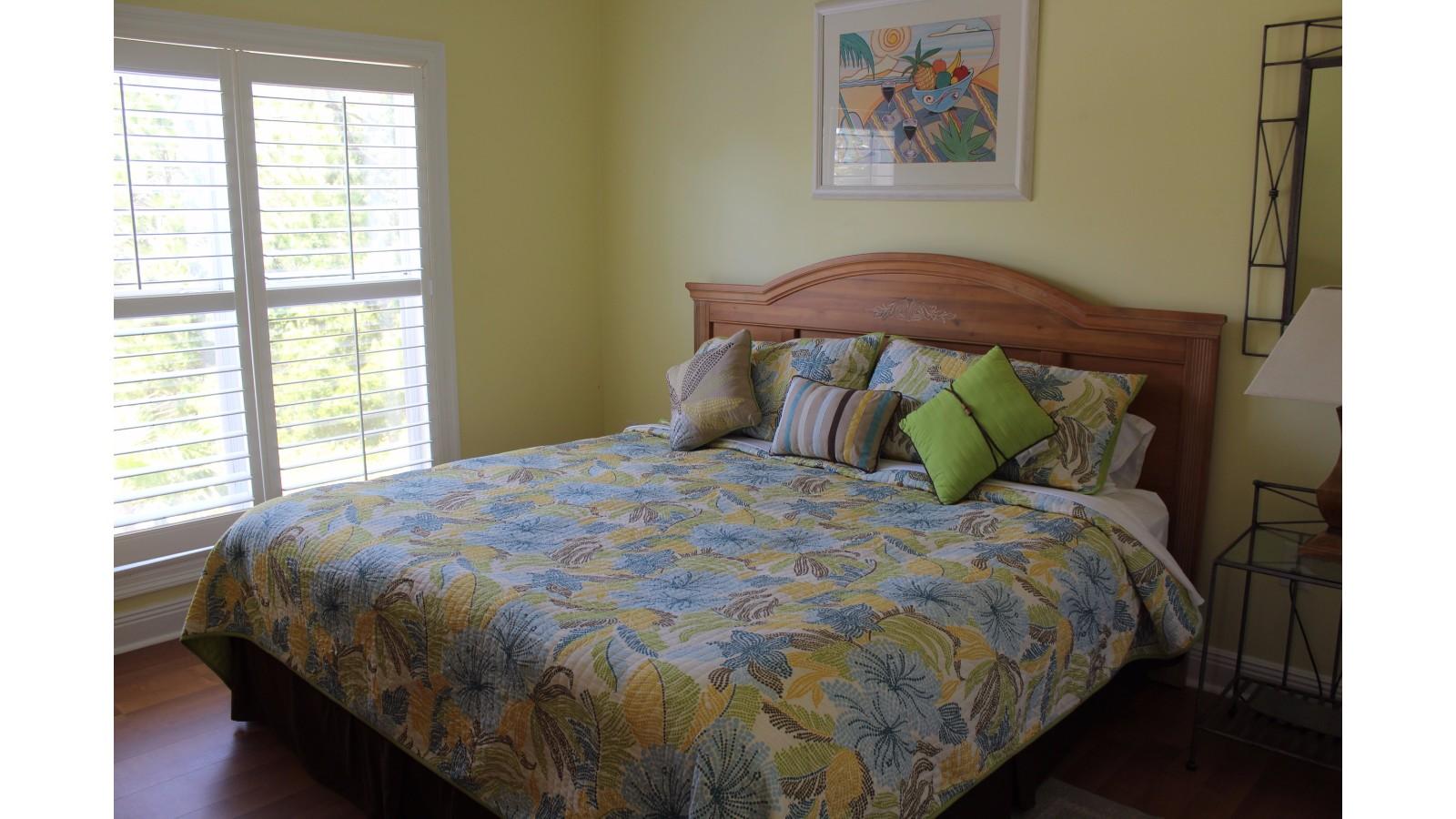 Yellow Bedroom, King Mattress, Main Floor, Bathroom Attached, Facing North/Road, TV and Closet