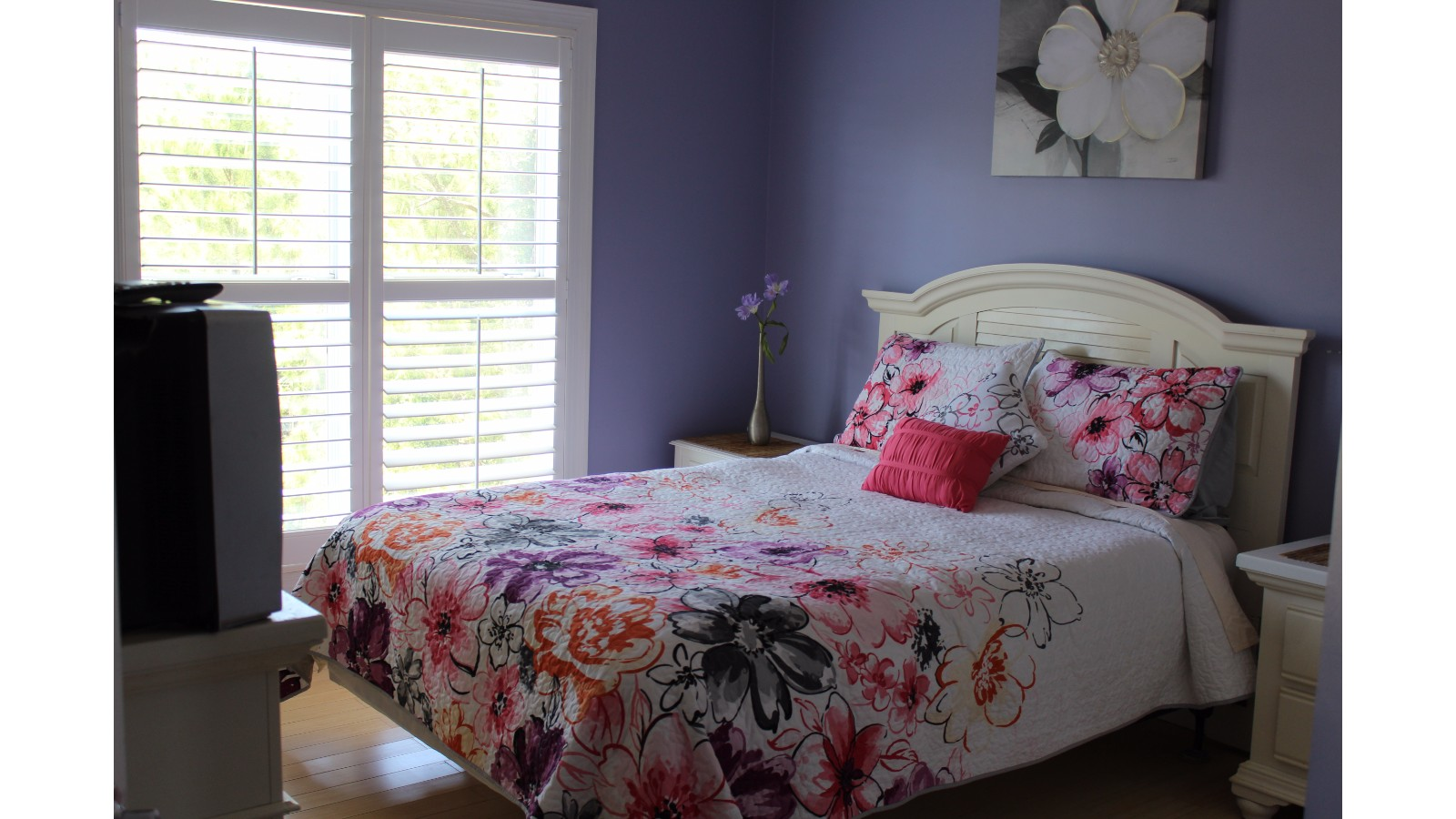 Purple Room, Queen Mattress, Bath Room Attached, Top Floor 1 of 2 Bedrooms , Facing Road, TV and Closet.