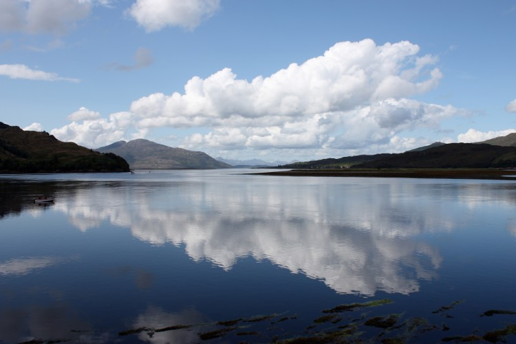 Clouds reflecting in Loch Alsh, seen from Eilean Donan castle, in the Scottish Highlands