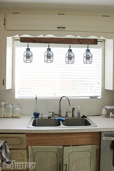 over the kitchen sink lighting setup ideas above inspiration four cage light idea