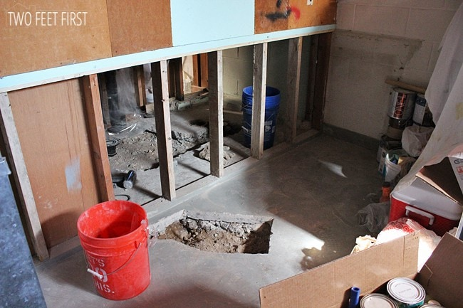 cutting-concrete-with-saw & Re-Cementing Basement Floor