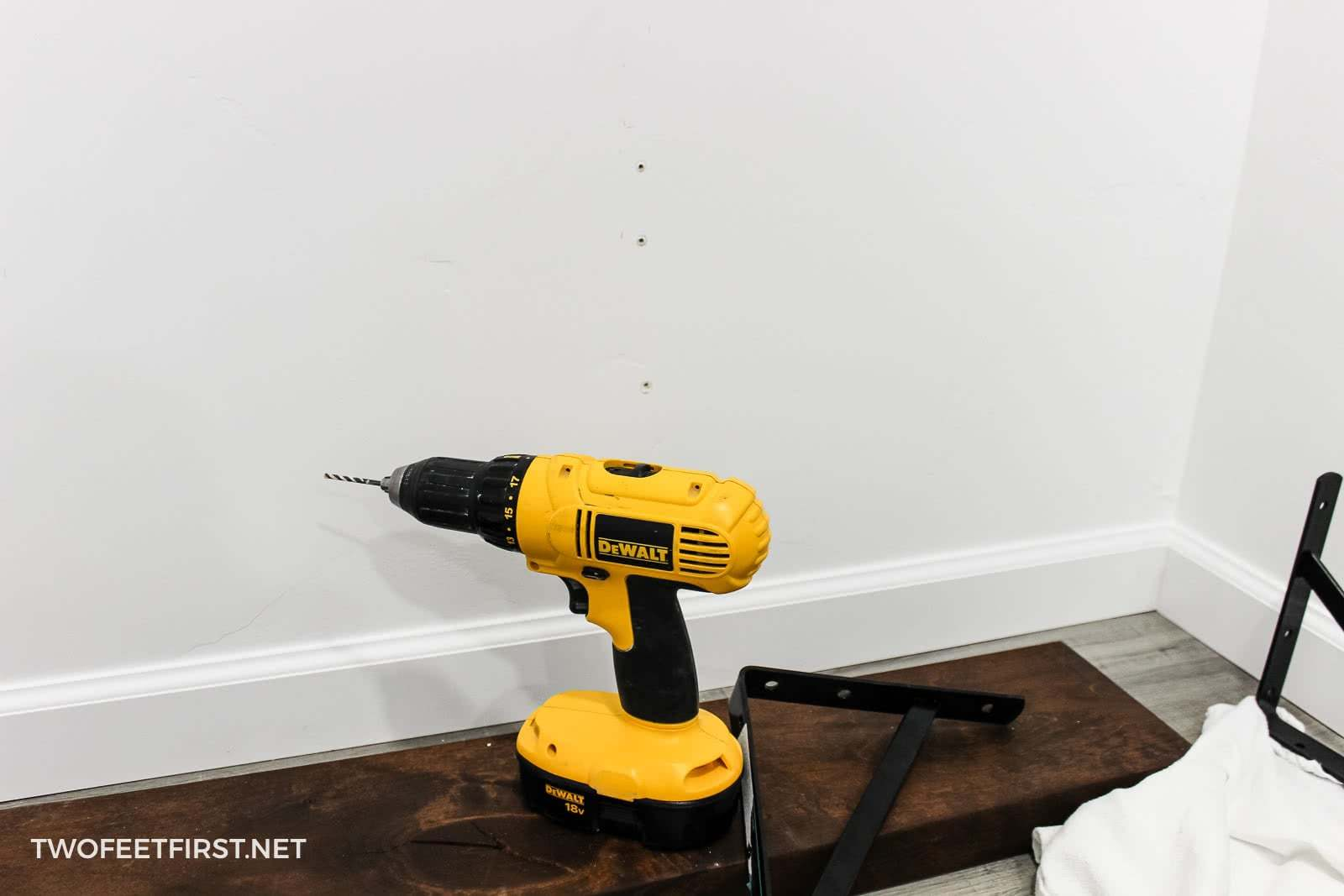 drill holes in wall for shelf bracket