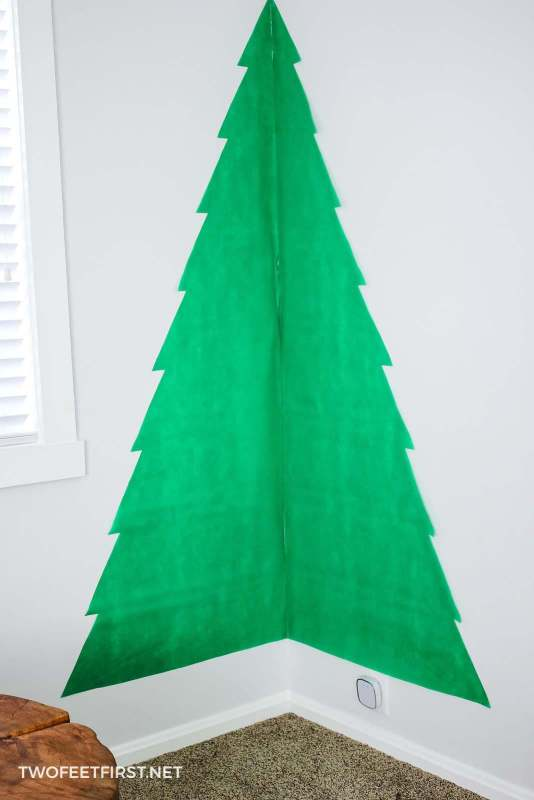 add fabric to wall for Christmas tree