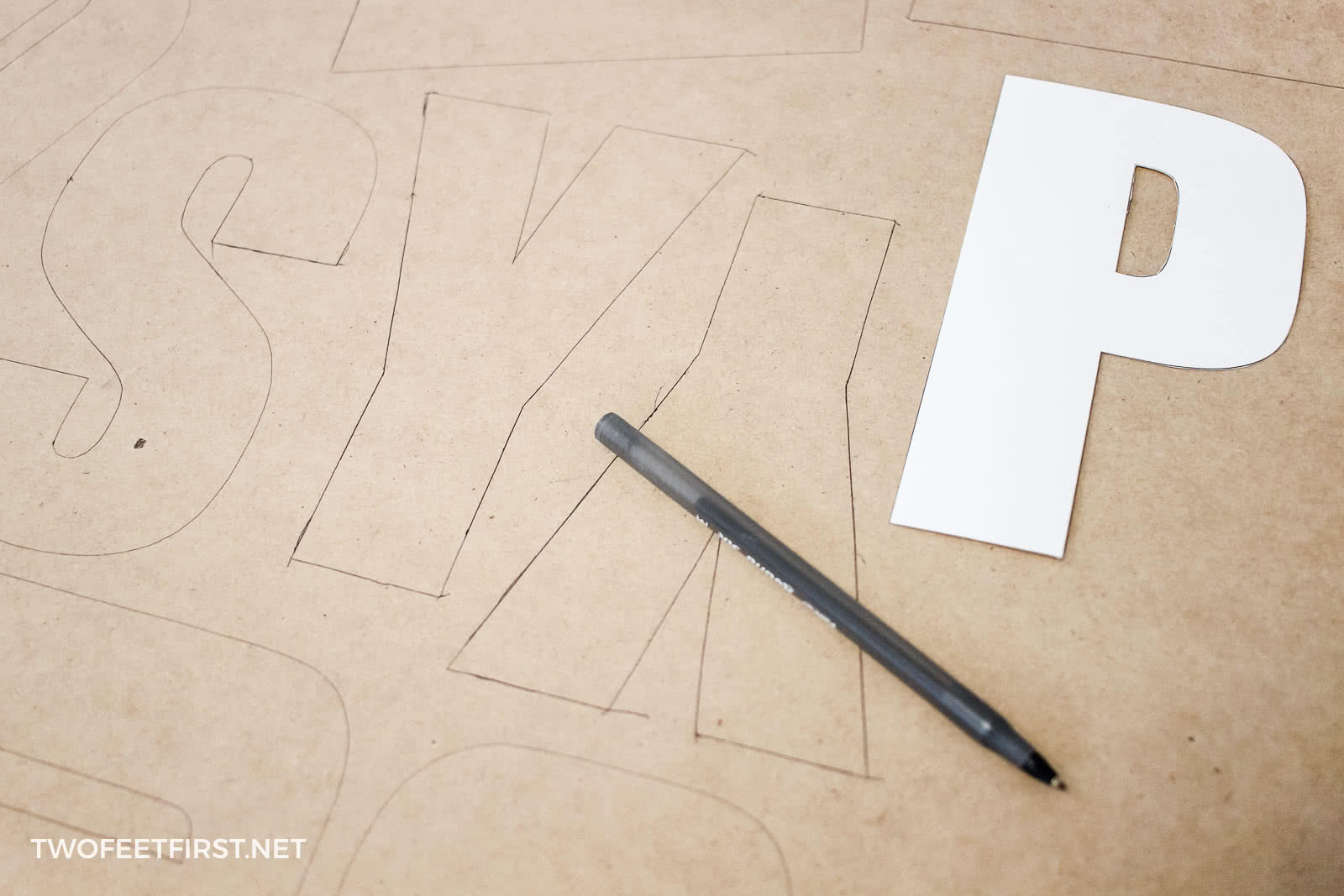 trace letters onto wood