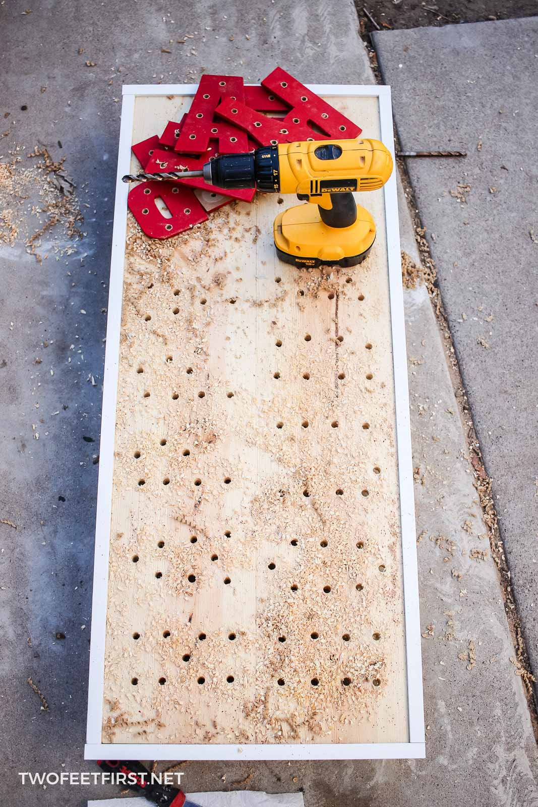 drilling holes in wood sign for lights