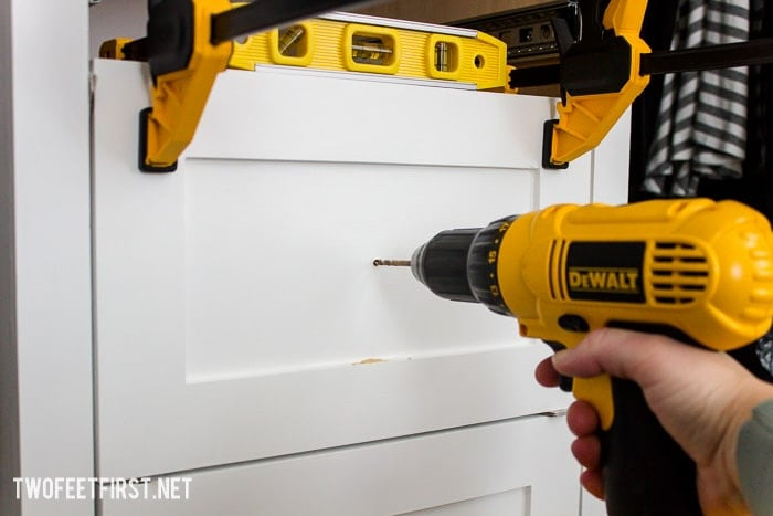 drilling cabinet hardware in drawer front