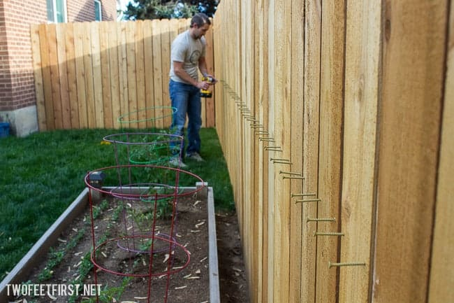 The process to rebuilding a fence.